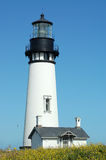 Ocean Lighthouse. A lighthouse sits on the coast on a bright sunny day stock images