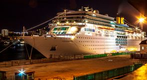 Ocean liner Costa Romantica moored at night on the pier in the downtown of the Far Eastern city of Vladivostok royalty free stock photo