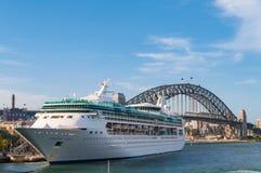 Ocean liner, cruise liner, ship with Sydney Harbour bridge on th. Sydney, Australia - December 2, 2008: Ocean liner, cruise liner, ship with Sydney Harbour Royalty Free Stock Photography