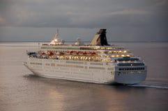 Ocean liner departing at dawn Stock Photos