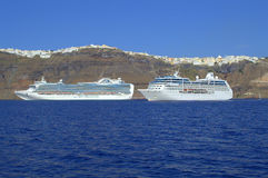 Cruises on the background of Thira, Santorini. Up is Thira,Santorini,Greece-photographed by the bay-amazing,heavenly place.This azure blue sea and sky and the Royalty Free Stock Photos