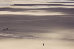 Ocean at low tide under blue cloudy sky, at Mont Saint Michelle Stock Images
