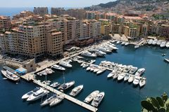 Ocean Marina of Yachts and Boats with Surrounding Condos, Apts, and Businesses. The beautiful blue water of the Mediterranean Sea is home to this Monte Carlo stock photo