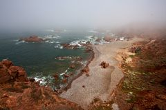 Ocean at mist Stock Photos