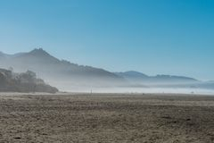 The ocean mist enters at sunset in Cannon Beach, Oregon, USA. royalty free stock images
