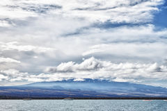 Ocean and mountains with cloudy sky Royalty Free Stock Photos