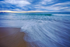 Ocean movement. Low tide at Hartenbos with white water textures Stock Photo