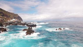 Ocean near clifs of Porto Moniz Madeira aerial view stock video footage