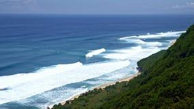 Ocean near green mountain. Ocean with waves near green mountain stock footage