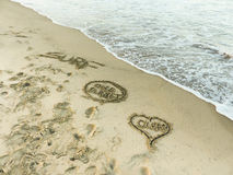 'Ocean, One Planet, Surf' Inspirational Sand Words Stock Photos