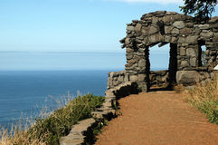 Ocean Overlook. An old rock shelter created by the Civilian Conservation Corps overlooks the Pacific ocean Stock Photo
