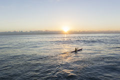 Ocean Paddler Surf-Ski Sunrise. Paddler ocean waters sunrise  training paddling surf ski Stock Image