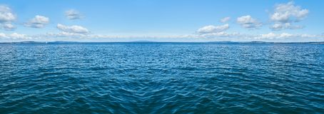 Free Ocean Panorama Background With Sky And Clouds Royalty Free Stock Photos - 155310768