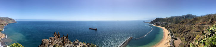 Ocean panorama with beach and boat / ship Stock Image