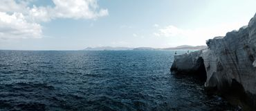 Ocean panorama. With tall stone shore Royalty Free Stock Image