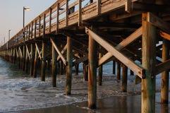 Ocean Pier. An ocean pier with lights still on at sunrise Stock Photos
