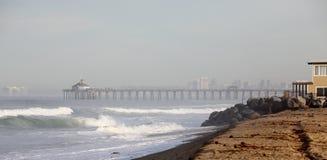 Ocean pier on a misty morning royalty free stock photos