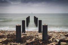 Ocean pier posts Sweden stock photo