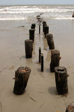 Ocean Pier Pylons. Ocean fishing pier pylons at Folly Beach near Charleston, SC Royalty Free Stock Photography