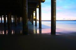 Ocean Pier Stilts At Sunset Stock Photo
