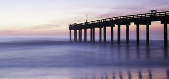Ocean pier at sunrise Stock Image