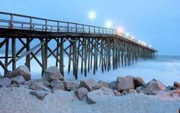 Ocean pier at twilight. Ocean pier on a beach at twilight Royalty Free Stock Photo