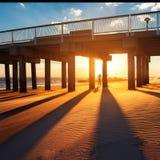Ocean pier under warm sunset royalty free stock photo