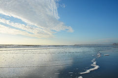 Ocean and pier view on a sunny morning. Stock Photo