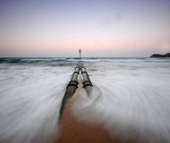 Ocean Pipe. Outlet pipe into ocean at beach Royalty Free Stock Photo