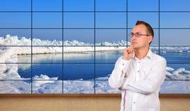 Ocean  on plasma panel. Businessman thinking in office and ice ocean  on plasma panel Stock Photo