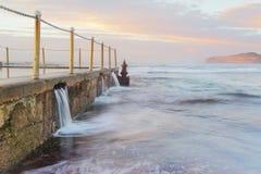Ocean pool overflows stock photos