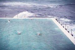Ocean pool. Swimmers at an ocean pool Royalty Free Stock Photo