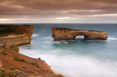 Ocean Power. Beautiful London bridge cliff at Port Campbell in South Australia. Great Ocean Road, 12 Apostles stock photo