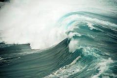 Ocean Powered Breaking Wave in Hawaii. An enormous wave rolls toward the Maui, Hawaii shoreline Stock Images