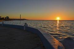 Ocean promenade at sunset royalty free stock photo