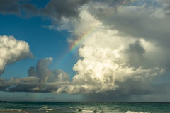 Ocean rainbow with stunning cloudscape Stock Photography