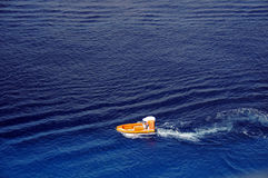 Ocean rescue. Boat conducting rescue operation at sea Stock Image