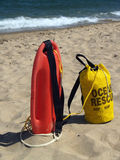Ocean Rescue Gear Ready in Sand. Ocean safety items on shore near lifeguard stand, Ocean Grove beach in New Jersey, U.S.A. Patrol rescue can and bag of rip tide stock image
