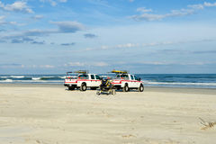 Ocean rescue trucks. Two ocean rescue trucks on the beach Royalty Free Stock Photography