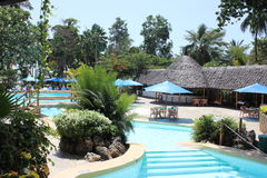 Ocean resort in Mombasa. Ocean resort with exotic pool garden in Mombasa, Kenya Royalty Free Stock Images