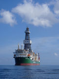 Ocean Rig Apollo. Drillship Ocean Rig Poseidon waiting for crew change in Port Louis, Mauritius on a beautiful April day Stock Photography