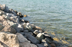 Ocean ripples near rocky shoreline Royalty Free Stock Photo