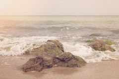 Ocean Rock Cliff Landscape, Rising From The Water. Travel Inspiration. Bulgarian Black Sea Coast. Vintage Toned Picture With Inst. Agram Filter Effect. Sun Haze royalty free stock images