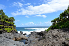 Ocean Rock Scene. Ocean view from the base of the seven sacred swimming pools at Ohe'o Gulch in Maui, Hawaii, USA. 7 water holes connected by waterfalls that are Stock Photo