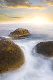 Ocean  and rock at the sunset. Royalty Free Stock Images
