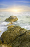 Ocean and rock at the sunset. Stock Photo