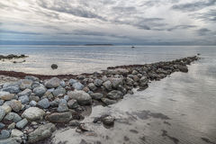 Ocean with Rocks and Clouds Stock Image