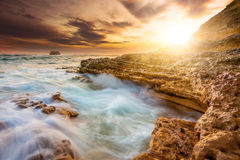 Ocean and Rocks. Sea waves crashing upon the rocks at Sorrento beach in Australia Royalty Free Stock Images