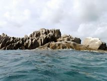 Ocean and rocks. Seychelles, somewhere in the Indian Ocean royalty free stock photography
