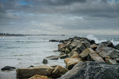 Ocean with rocks, wave, sky, clouds, and waves. At Venice Beach, California Royalty Free Stock Photo